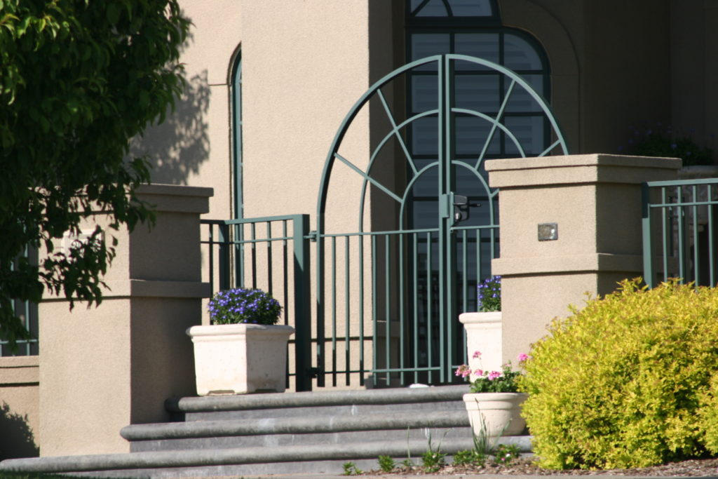 Custom arched swing gate for a home