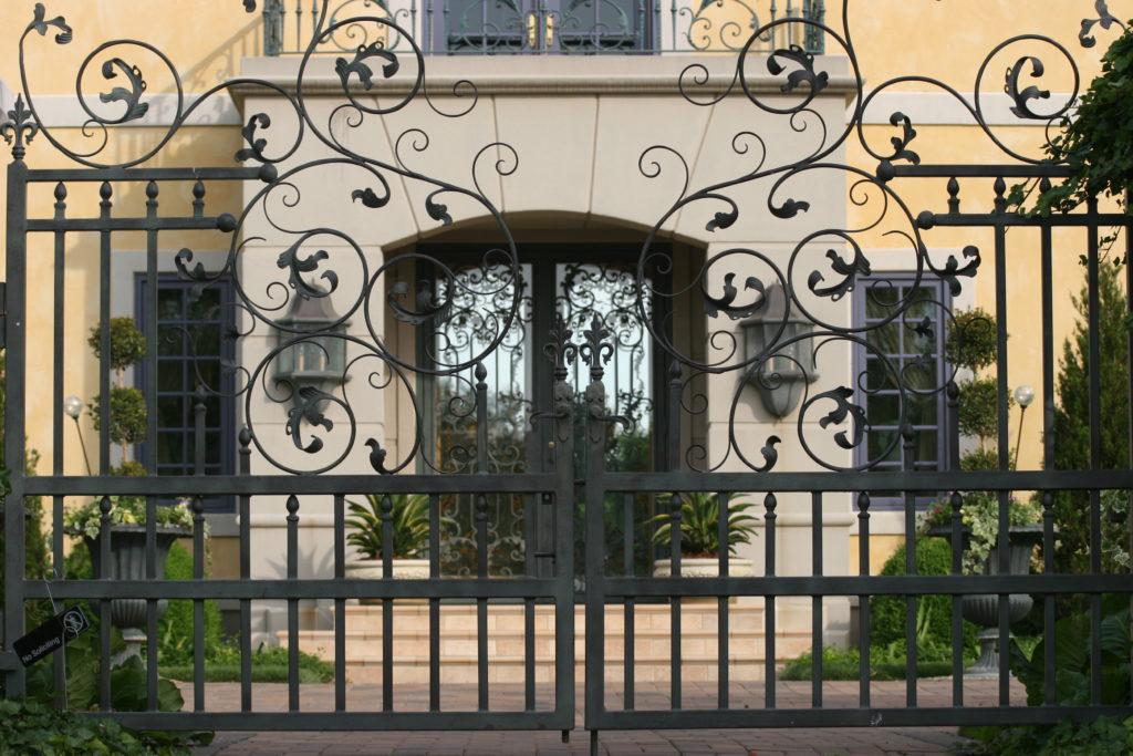 Custom ornamental swing gate with ivy detailing
