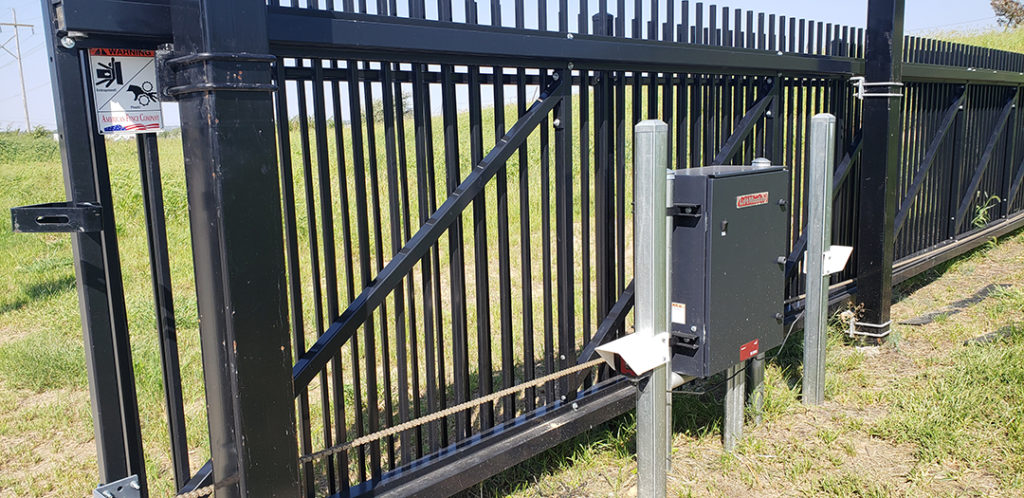 Cantilever gate operator with photo eyes and automated slide gate safety signs