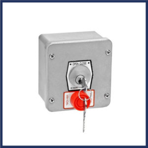 Gate keyed switch with stop button. Tamper-proof. Mortise cylinder. Emergency stop button.