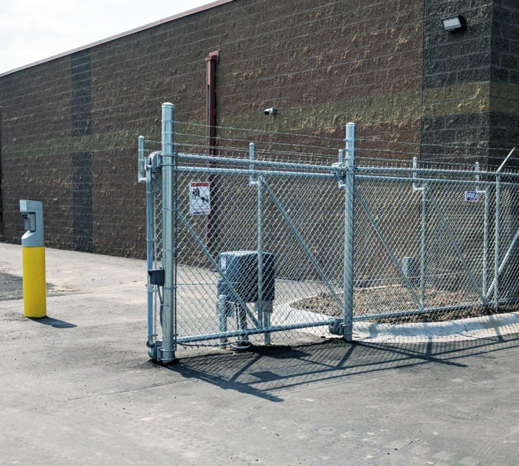 Chain link cantilever gate with barb wire and a slide gate operator