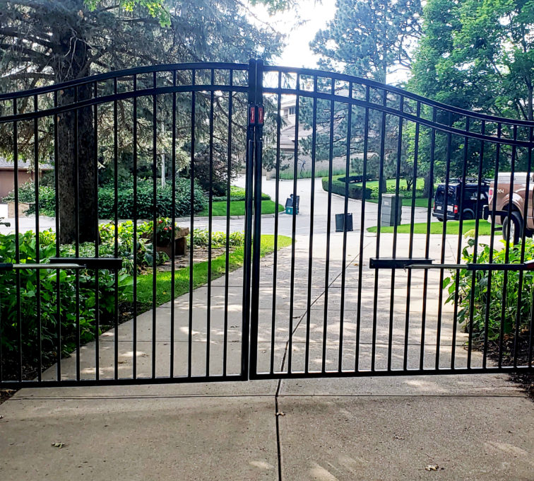 Automated ornamental double drive swing gate at a residential property