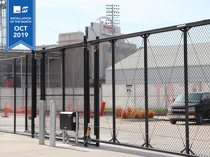 Installation of the Month of October, 2019 for HySecurity. Featured is a black chain link cantilever gate with the SlideSmart HD25 gate operator installed