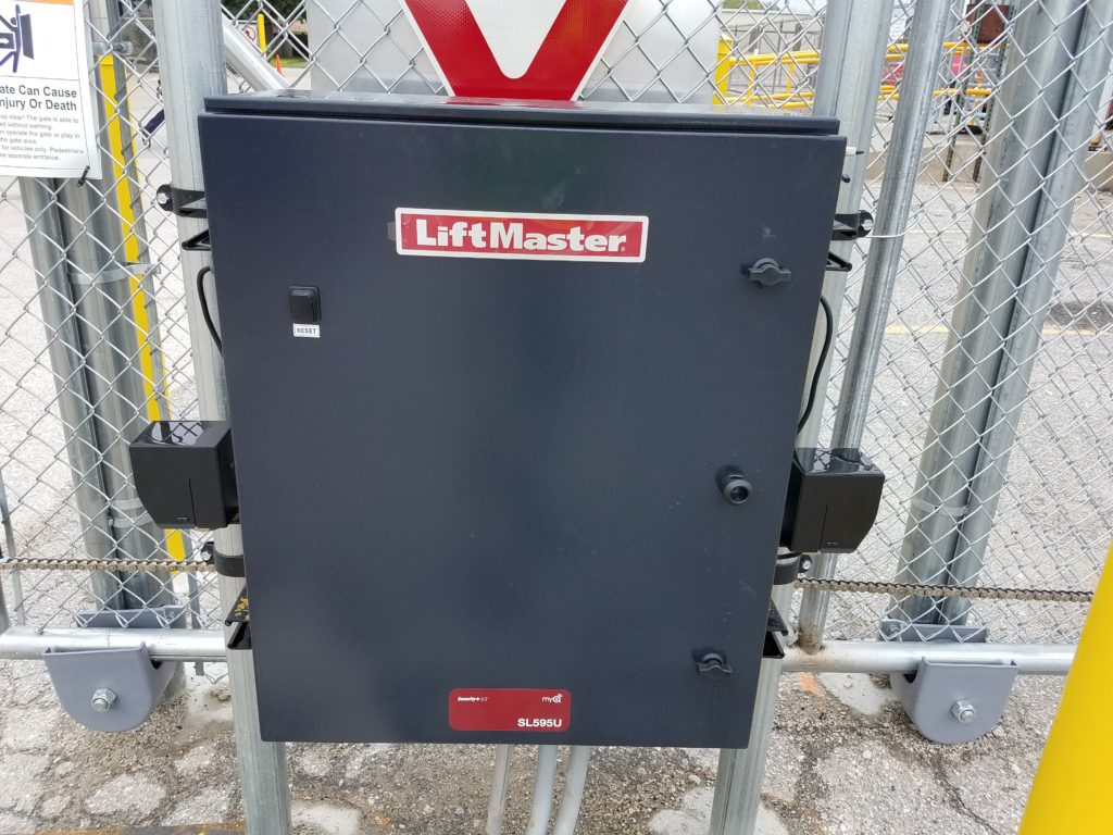 Automated gate operator control box.  access control Omaha, Nebraska commercial gate installation company automated electric gate opener operators solar motor motorized automatic access control driveway estate slide swing rolling cantilever vertical lift vertical pivot open close stop key pad switch push button three button control intercom call button telephone entry computerized entry loop exit obstruction shadow detector transmitter receiver radio frequency wifi box cantilever aluminum